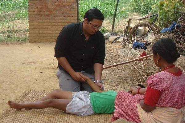 Dr Thapa and patient in Nepal