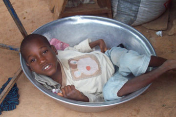 Abandoned child with cerebral palsy in Ghana