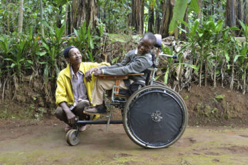 Boy in wheelchair and parent